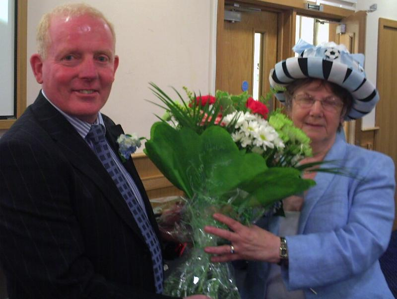 Ian Wallace with hat competition winner Valerie Birch